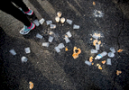Sports Photographer of the Year Ben McKeown, Freelance Uneaten doughnuts and empty cups of water sit on the ground near a participant in the Krispy Kreme Challenge in Raleigh, N.C. on Saturday, Feb. 6, 2016.