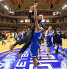 Sports Photographer of the Year Ben McKeown, Freelance UNC Asheville's Sam Hughes (31) lifts coach Nick McDevitt into the air after winning an NCAA college basketball championship game in the Big South Conference tournament in Buies Creek, N.C., Sunday, March 6, 2016.