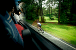 Sports Photographer of the Year Ben McKeown, Freelance A cyclist is seen from inside a spectator bus during the Ironman 70.3 race in Raleigh, N.C. on Sunday, June 5, 2016.