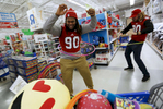 Sports POY: Runner UpEamon Queeney, North State Journal North Carolina State defensive tackle Ben Frazier (90), left, and punter A.J. Cole III (90), right, try out hula hoops as they pick out toys to buy as part of the Marine Corps Reserve Toys for Tots program at a Toys R Us in Raleigh, Tuesday, December 20, 2016. Each player got to pick out 100 toys each under $30 to donate to less fortunate children in North Carolina.