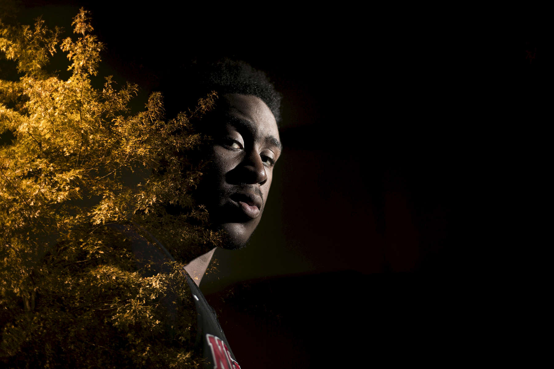 Sports POY: Runner UpEamon Queeney, North State Journal Seen in a double exposure created in camera, North Carolina State forward Abdul-Malik Abu (0) poses for a photograph at the Dail Basketball Center in Raleigh, Tuesday, November 15, 2016.