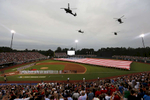 Sports POY: Runner UpEamon Queeney, North State Journal Helicopters fly over the field as soldiers wave a giant flag for the playing of the national anthem before the Major League Baseball game between the Atlanta Braves and the Miami Marlins at Fort Bragg in North Carolina, Sunday, July 3, 2016. Today's game goes down in history as the first regular-season professional game of any sport played on an active military base. The Miami Marlins defeated the Atlanta Braves 5 - 2.