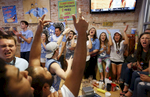 Sports POY: Runner UpEamon Queeney, North State Journal North Carolina fans react to a basket as they watch the NCAA men's basketball championship game inside of Sup Dogs on Franklin Street in Chapel Hill, Monday, April 4, 2016. Villanova defeated North Carolina 77 - 74 to win the NCAA men's basketball national championship at NRG Stadium in Houston.