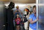 Sports POY: Runner UpEamon Queeney, North State Journal Staff member Alaina Poe holds the door for Darth Vader and a Stormtrooper as they ride the elevator with Bulls fans during Star Wars night at the baseball game between the Durham Bulls and the Norfolk Tides at the Durham Bulls Athletic Park, Saturday, May 7, 2016. The Durham Bulls defeated the Norfolk Tides 2 - 1 in extra innings.