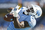 Sports POY: Runner UpEamon Queeney, North State Journal North Carolina Tar Heels running back T.J. Logan (8) gets a hand on a pass but fails to complete in the first quarter of the college football game against the Georgia Tech Yellow Jackets at Kenan Memorial Stadium in Chapel Hill, Saturday, November 5, 2016. The North Carolina Tar Heels defeated the Georgia Tech Yellow Jackets 48 - 20.