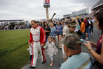 Sports POY: Runner UpEamon Queeney, North State Journal Driver Ryan Newman walks to the introduction ceremony with his daughters Ashlyn and Brooklyn during the Coca-Cola 600 at Charlotte Motor Speedway, Sunday, May 29, 2016. Martin Truex Jr. made NASCAR history in his No. 78 Furniture Row Racing Toyota by leading more laps and more miles than any other driver in any race in NASCAR history while landing himself in Victory Lane.