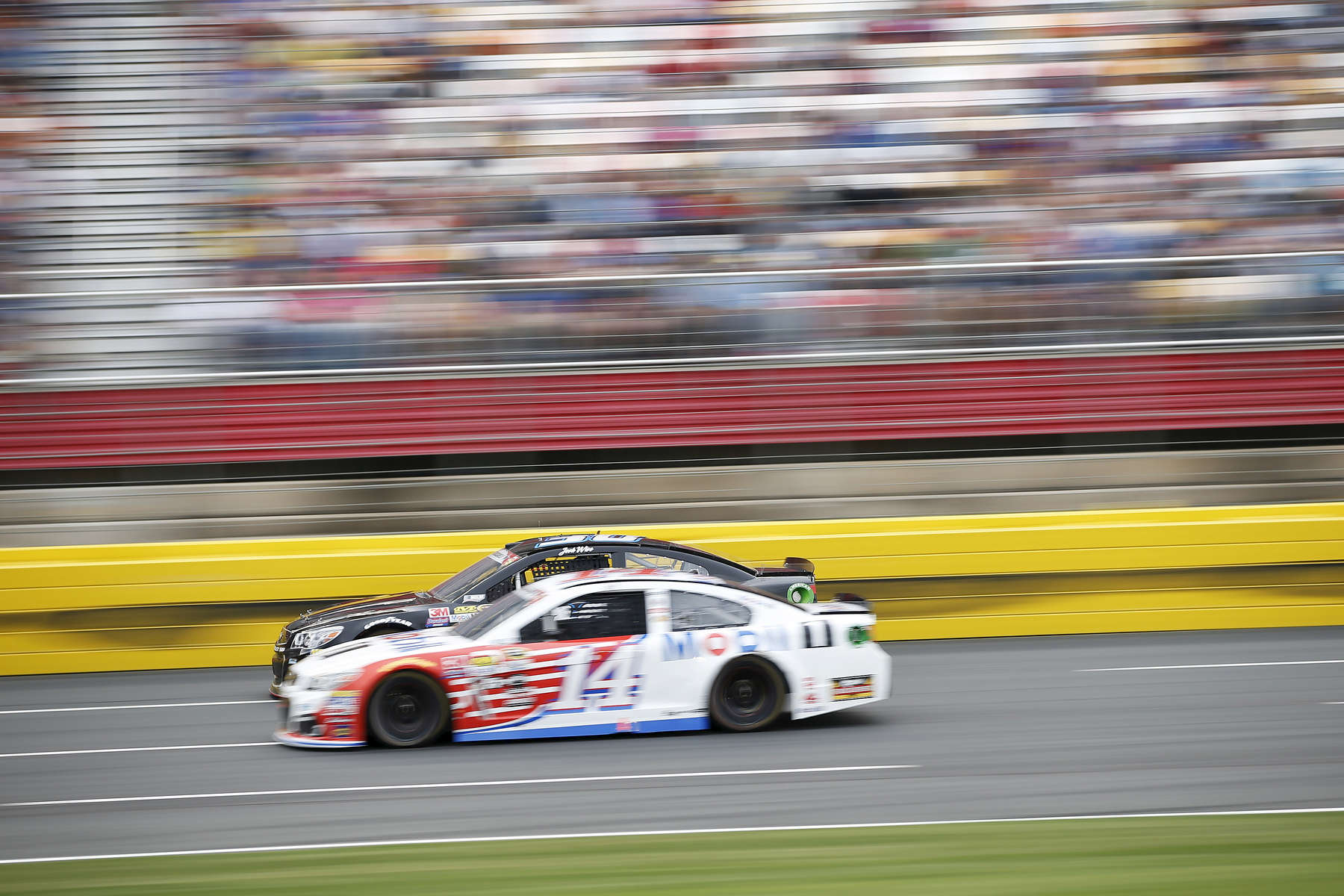 Sports POY: Runner UpEamon Queeney, North State Journal Tony Stewart in the No. 14. Mobil 1 Chevrolet passes Josh Wise in the No. 30 Curtis Key Plumbing Chevrolet during the Coca-Cola 600 at Charlotte Motor Speedway, Sunday, May 29, 2016. Martin Truex Jr. made NASCAR history in his No. 78 Furniture Row Racing Toyota by leading more laps and more miles than any other driver in any race in NASCAR history while landing himself in Victory Lane.