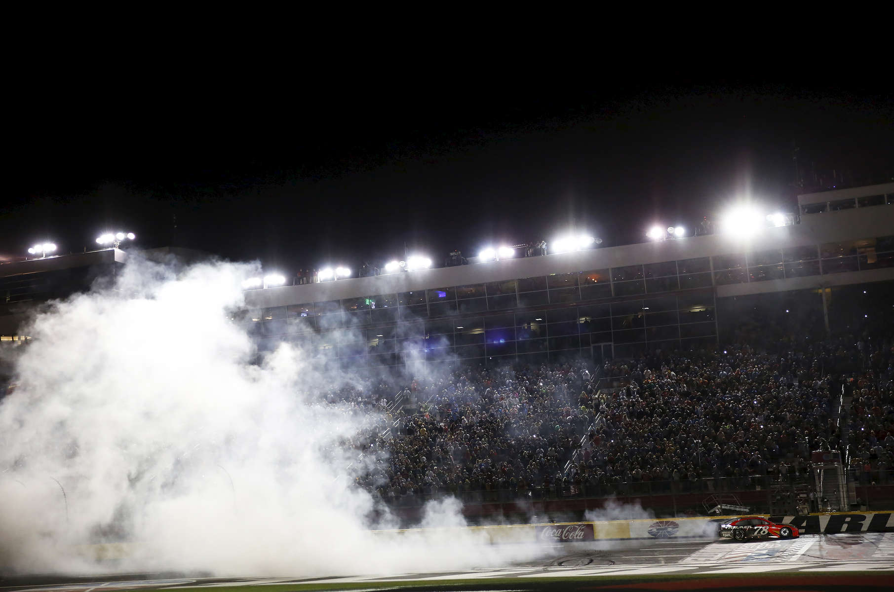 Sports POY: Runner UpEamon Queeney, North State Journal Martin Truex Jr. in the No. 78 Furniture Row Racing Toyota does a celebratory burnout after the Coca-Cola 600 at Charlotte Motor Speedway, Sunday, May 29, 2016. Martin Truex Jr. made NASCAR history in his No. 78 Furniture Row Racing Toyota by leading more laps and more miles than any other driver in any race in NASCAR history while landing himself in Victory Lane.