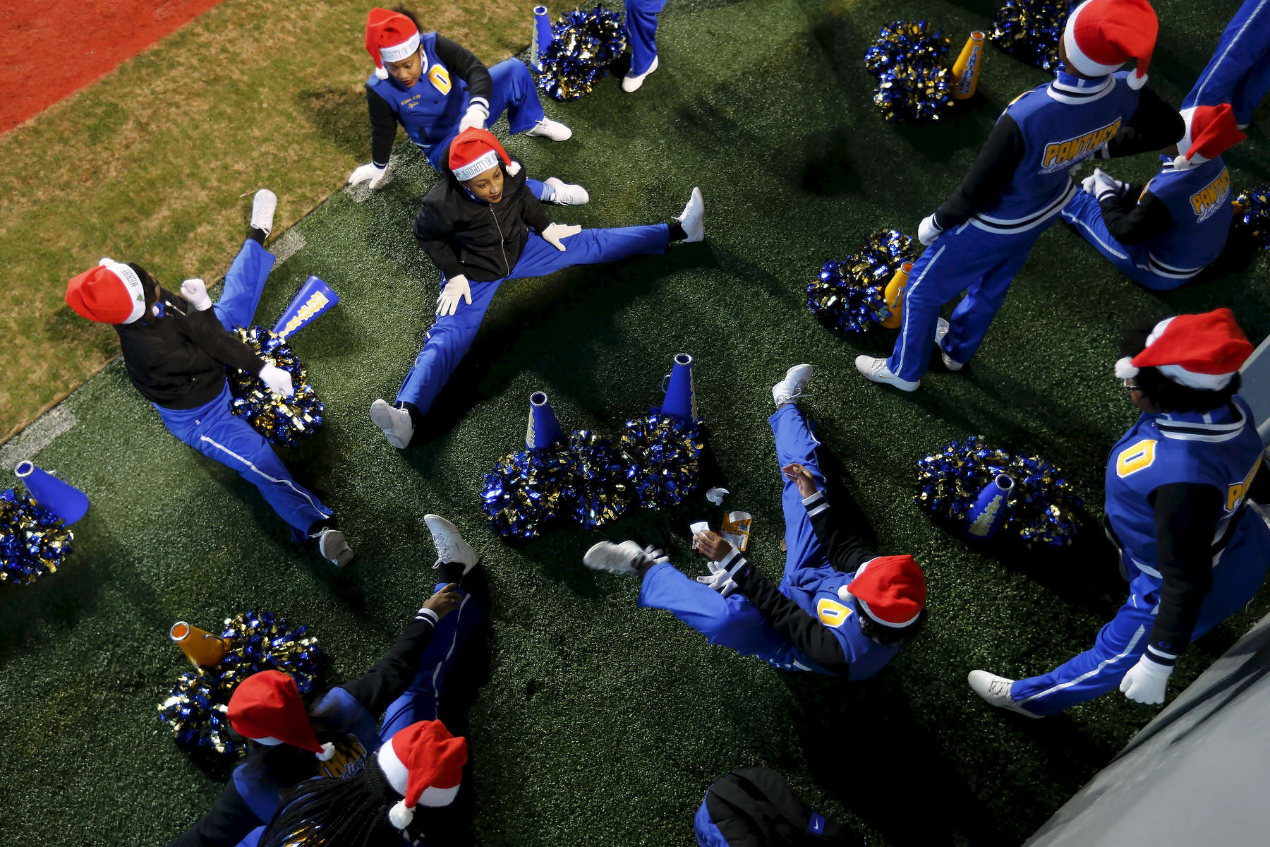 Sports POY: Runner UpEamon Queeney, North State Journal Dudley Panthers cheerleaders stretch before the NCHSAA Division 4A State Championship football game against the Cape Fear Colts at Carter-Finley Stadium in Raleigh, Saturday, December 17, 2016. The Dudley Panthers defeated the Cape Fear Colts 54 - 0.