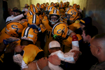 Sports POY: Runner UpEamon Queeney, North State Journal Cape Fear Colts senior Darrius Jackson (44) looks up as the team huddles up in the tunnel before running on to the field for the NCHSAA Division 4A State Championship football game against the Dudley Panthers at Carter-Finley Stadium in Raleigh, Saturday, December 17, 2016. The Dudley Panthers defeated the Cape Fear Colts 54 - 0.