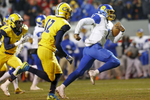 Sports POY: Runner UpEamon Queeney, North State Journal Dudley Panthers senior Hendon Hooker (1) rushes for a touchdown under pressure from the Cape Fear Colts defense in the first quarter of the NCHSAA Division 4A State Championship football game at Carter-Finley Stadium in Raleigh, Saturday, December 17, 2016. The Dudley Panthers defeated the Cape Fear Colts 54 - 0.