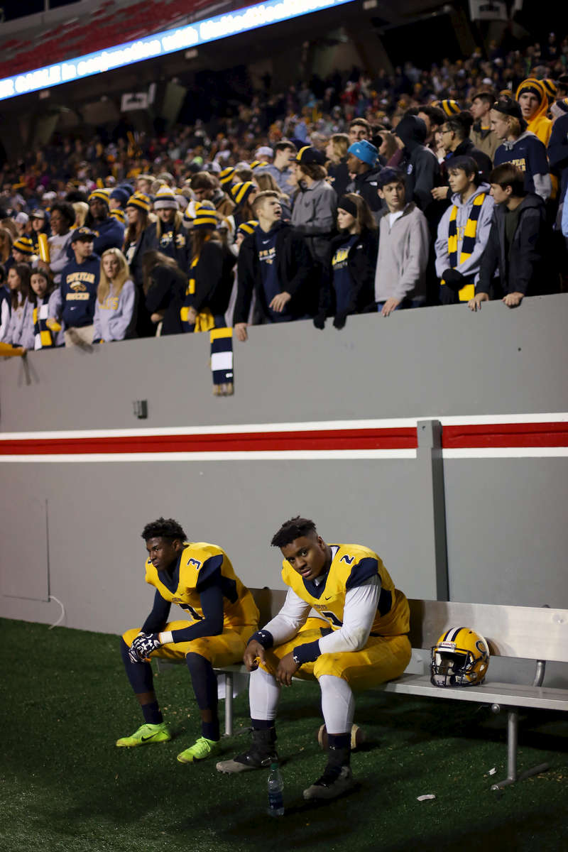 Sports POY: Runner UpEamon Queeney, North State Journal Cape Fear Colts junior Justice Galloway-Velazquez (2) and Cape Fear Colts senior Aj Baldwin (3) react on the bench in the third quarter of the NCHSAA Division 4A State Championship football game at Carter-Finley Stadium in Raleigh, Saturday, December 17, 2016. The Dudley Panthers defeated the Cape Fear Colts 54 - 0.