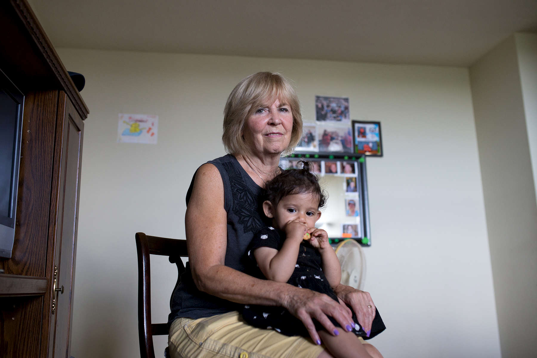 Carole Atkins holds baby Julia in the Hajj Mouhamed Ali family home in Toronto.