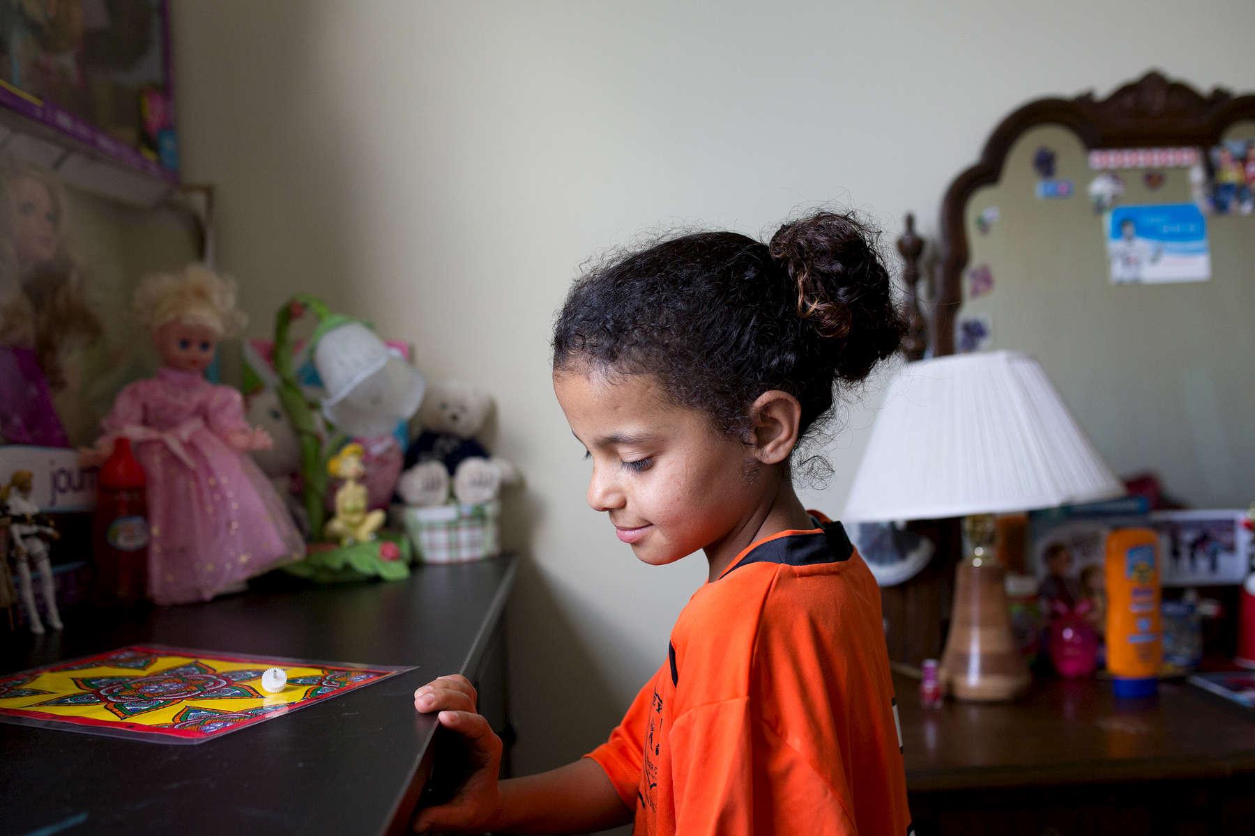 Zahiya in her room in her family home in Toronto.