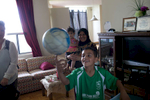 Moutayam spins a soccer ball on his finger in his family home in Toronto.