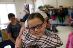 Randa Alftih hugs Addison Miller, a student from Laura Smith's grade 3 class at Edmison Heights Public School.