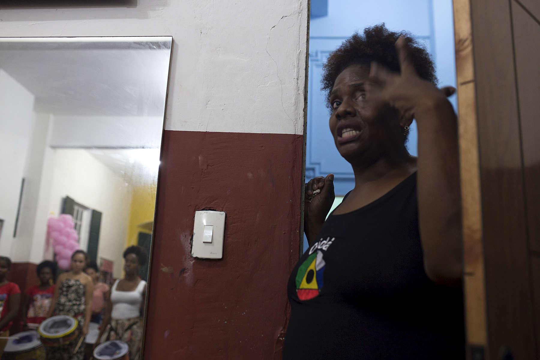 Deborah Souza, daughter of Didá founder Neguinho do Samba, talks to band members during practice at Project Didá in Salvador's historic neighborhood, Pelourinho.