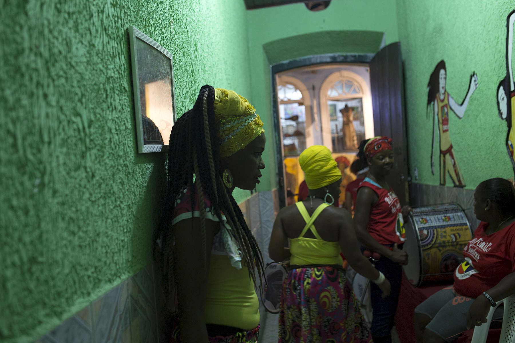 Adriana Portela (left) waits in the front hallway of Project Didá in Salvador's historic neighborhood, Pelourinho before a performance.