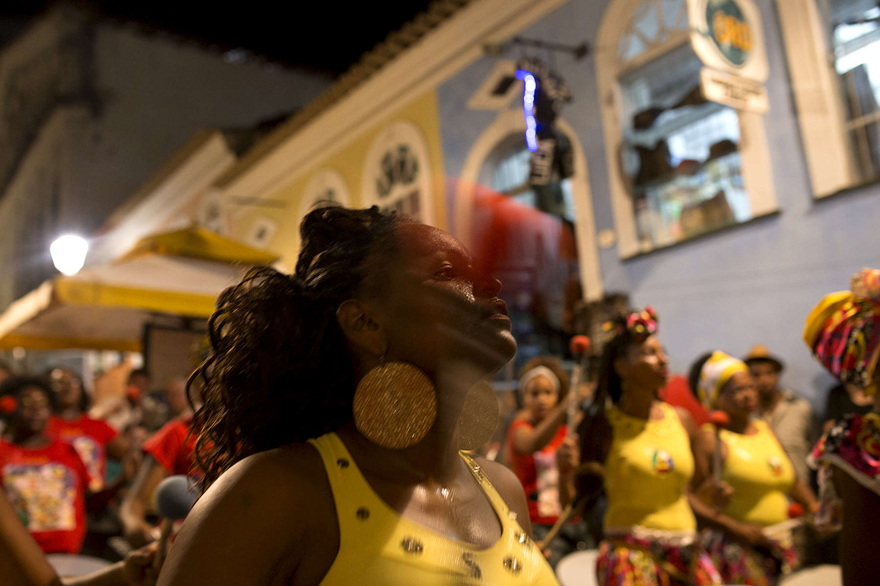 Marina de Oliveira Santos performs with the Didá band on the street outside Project Didá in Salvador's historic neighborhood, Pelourinho.