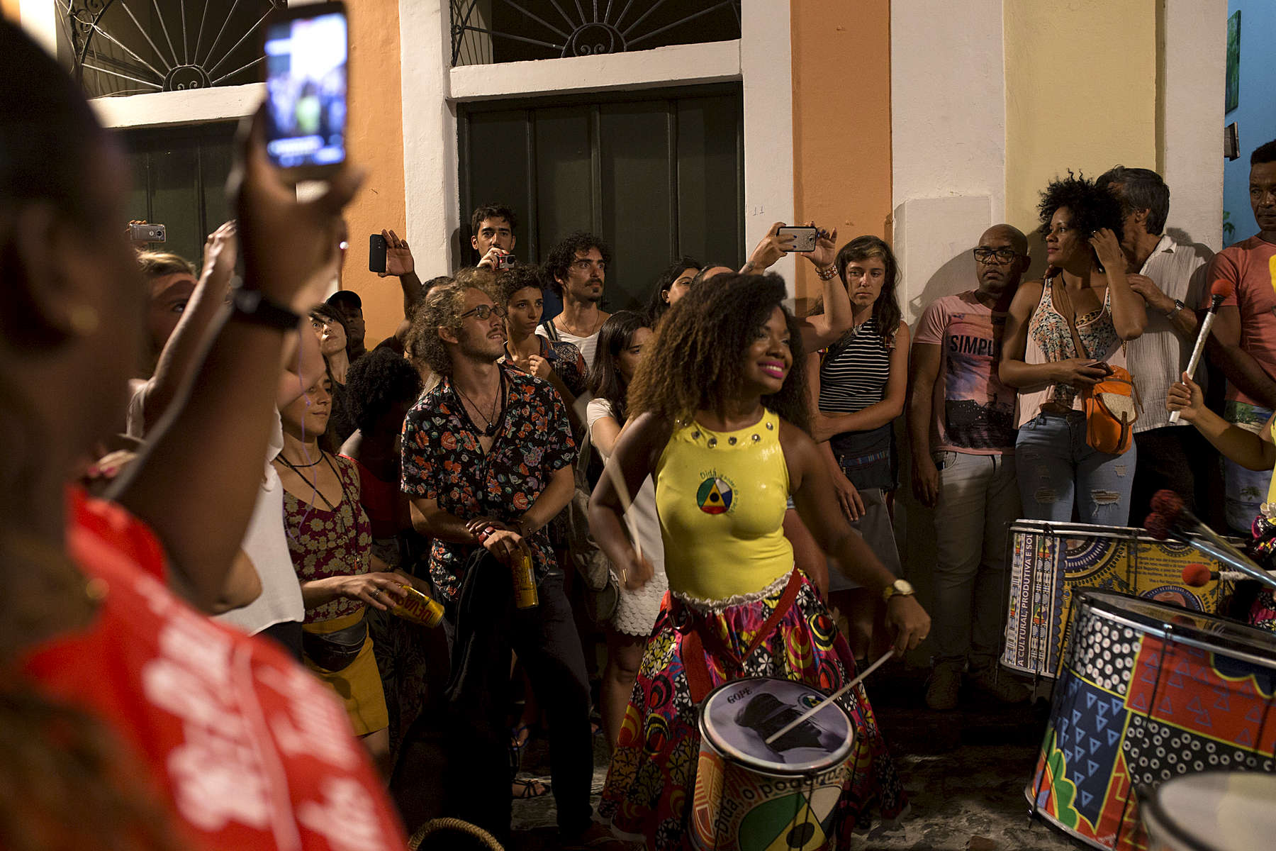 Ivone Cruz leads the Didá band infront of a group of onlookers watching the performance on the street outside Project Didá in Salvador's historic neighborhood, Pelourinho.