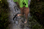 Ivan Moreira's muddy feet on the shore of the Amazon River.
