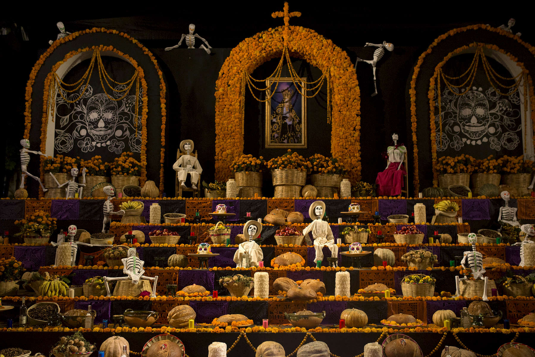 An altar display with pan de muerto in Zócalo in Oaxaca City.