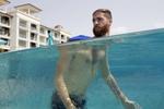 Joel Balsam swims in a pool at Sandals Resort in Barbados.