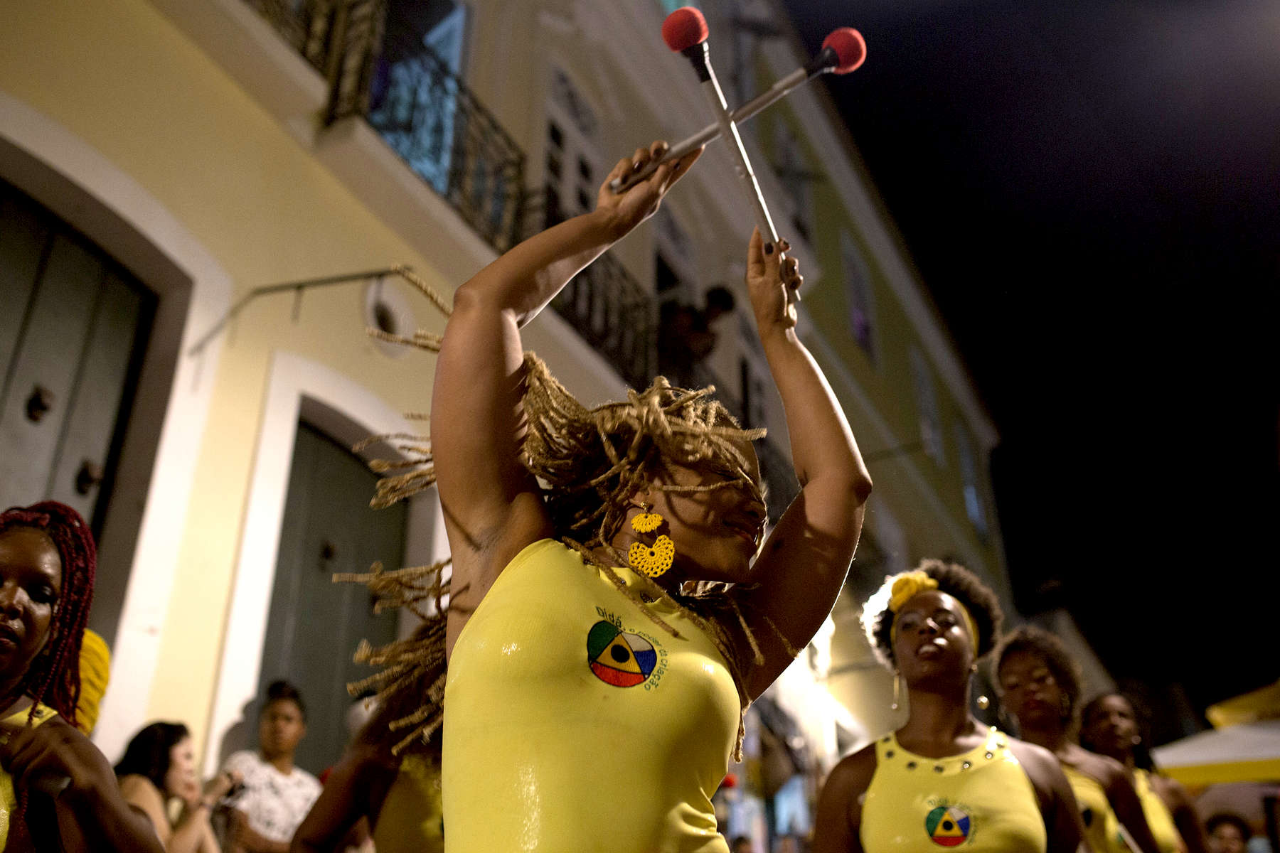 Víviam Caroline, centre, plays with Didá on the street outside Project Didá in Salvador's historic neighborhood, Pelourinho.