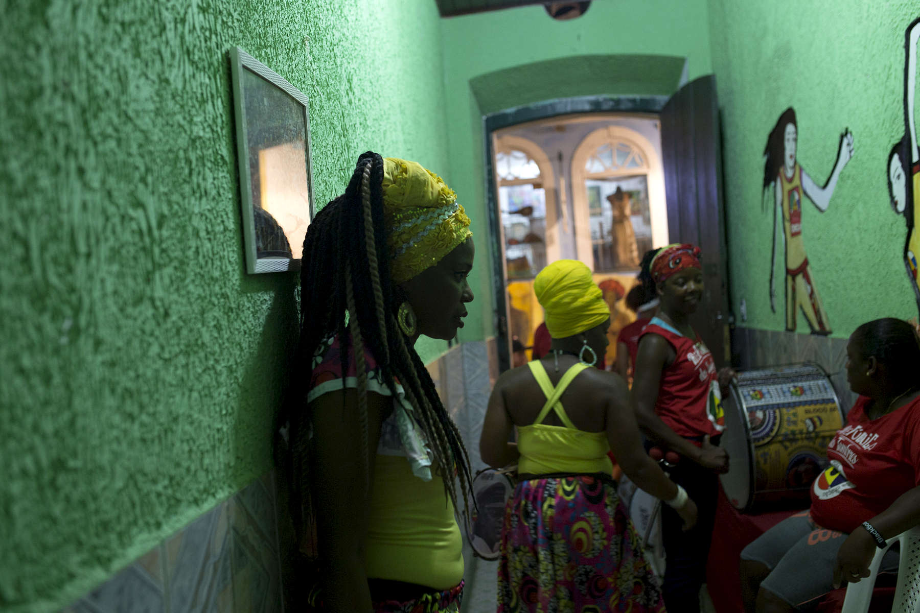 Adriana Portela, left, waits in the front hallway of Project Didá before a performance.