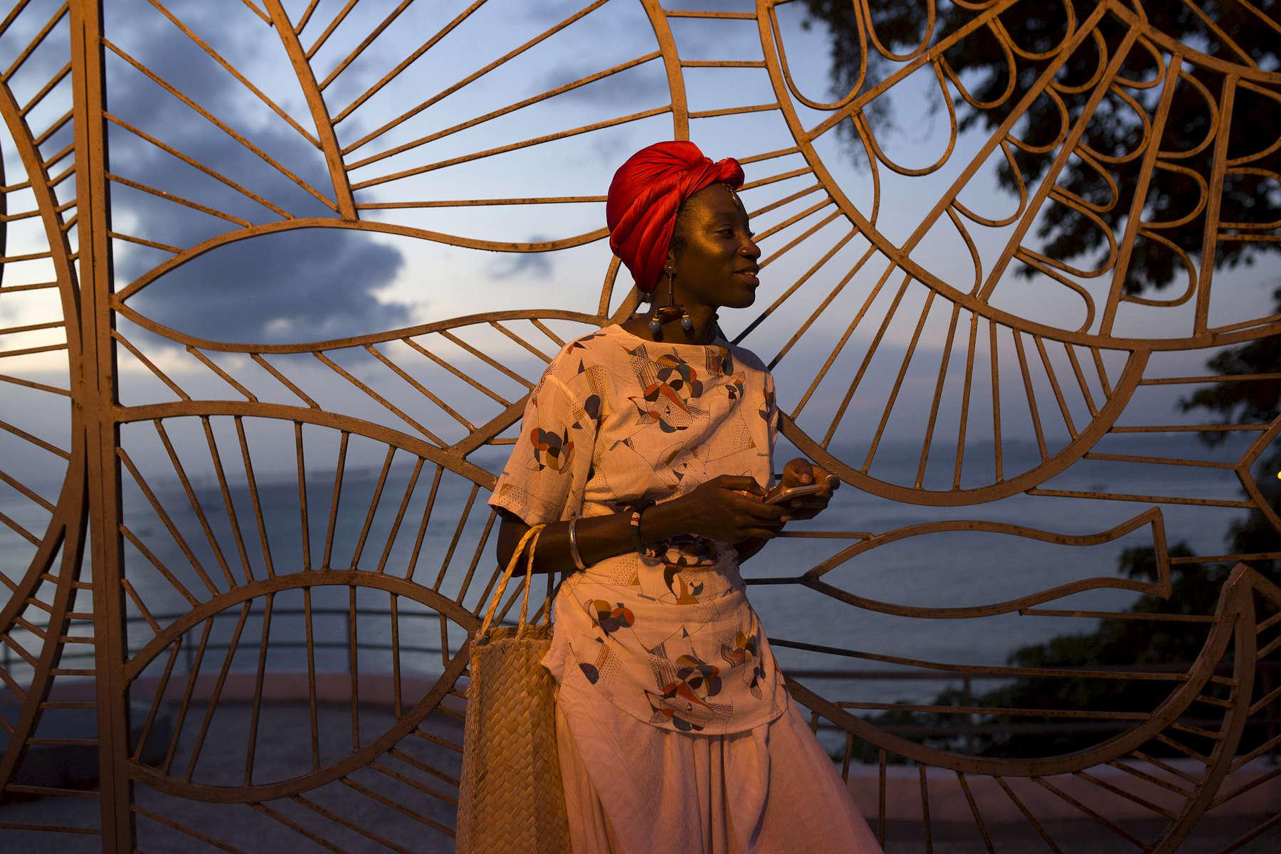 Luma Nascimento waits for an Uber outside Salvador's Museum of Modern Art. Luma is an artist and writer who dedicates who work to empowering Afro-Brazilian women.