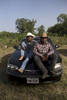 Xavier McNeal and James Wilborn sit on a car at the trail ride.