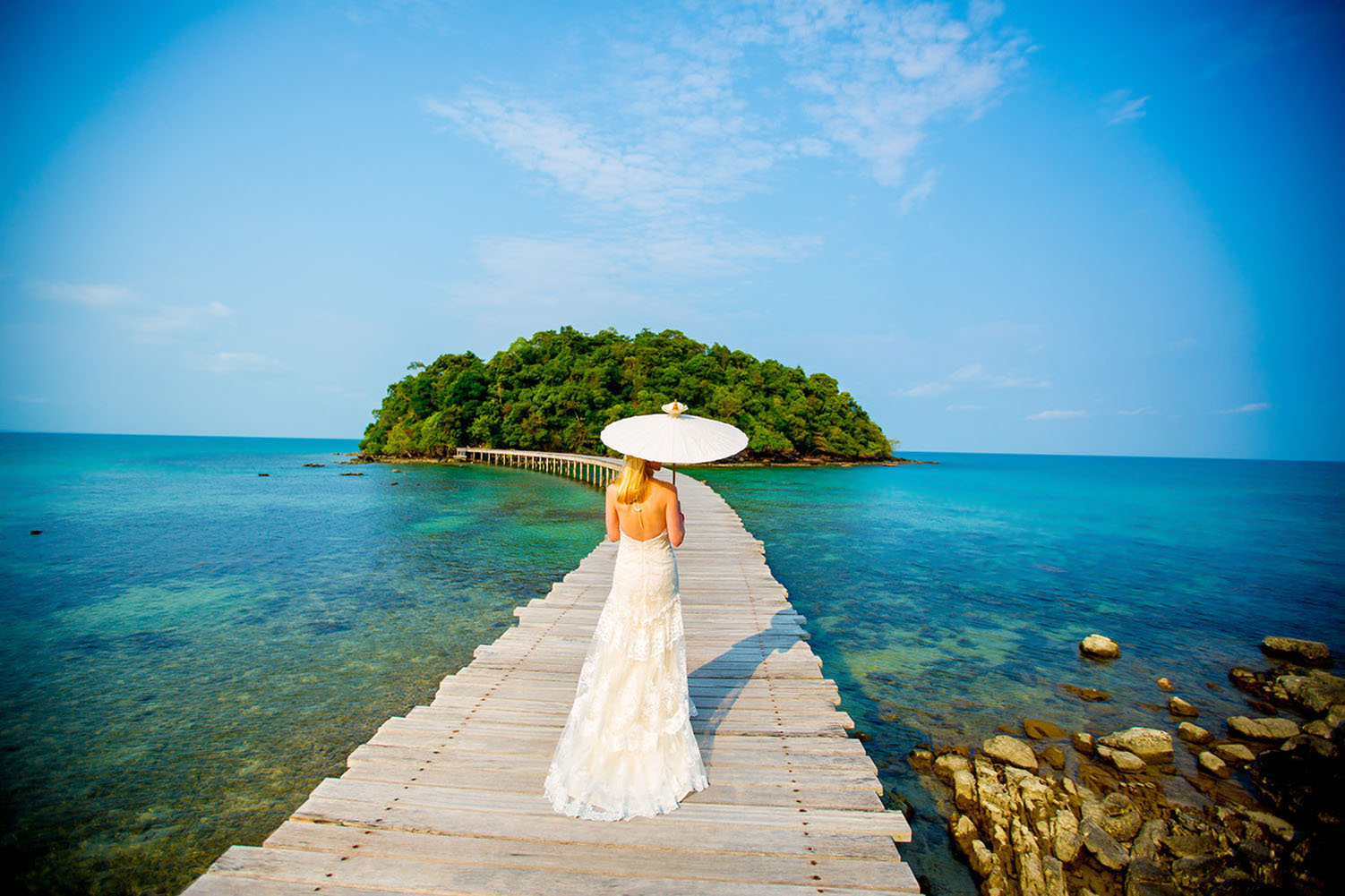 A portrait of a bride on an island at Song Saa Private Island Resort in Cambodia. Photography by Mott Visuals Weddings.
