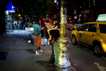 Manhattan, NY - July 29, 2018: Revelers embrace Stanton St. in the Lower East Side bar district in Manhattan, NY. Community groups are questioning the New York State Liquor Authority's practice of granting licenses in neighborhoods already saturated with bars and clubs.CREDIT: Kevin Hagen for The New York Times