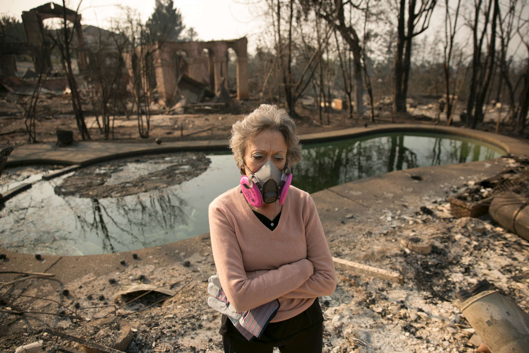 Santa Rosa, CA - October 11, 2017: Patti Hurley returned to her home in the Fountaingrove section of Santa Rosa, Calif. Hurley, with her husband Patrick and two children, lived in the two-story home for 26 years before it burned to the ground during this week's wildfires. CREDIT: Kevin Hagen for The New York Times