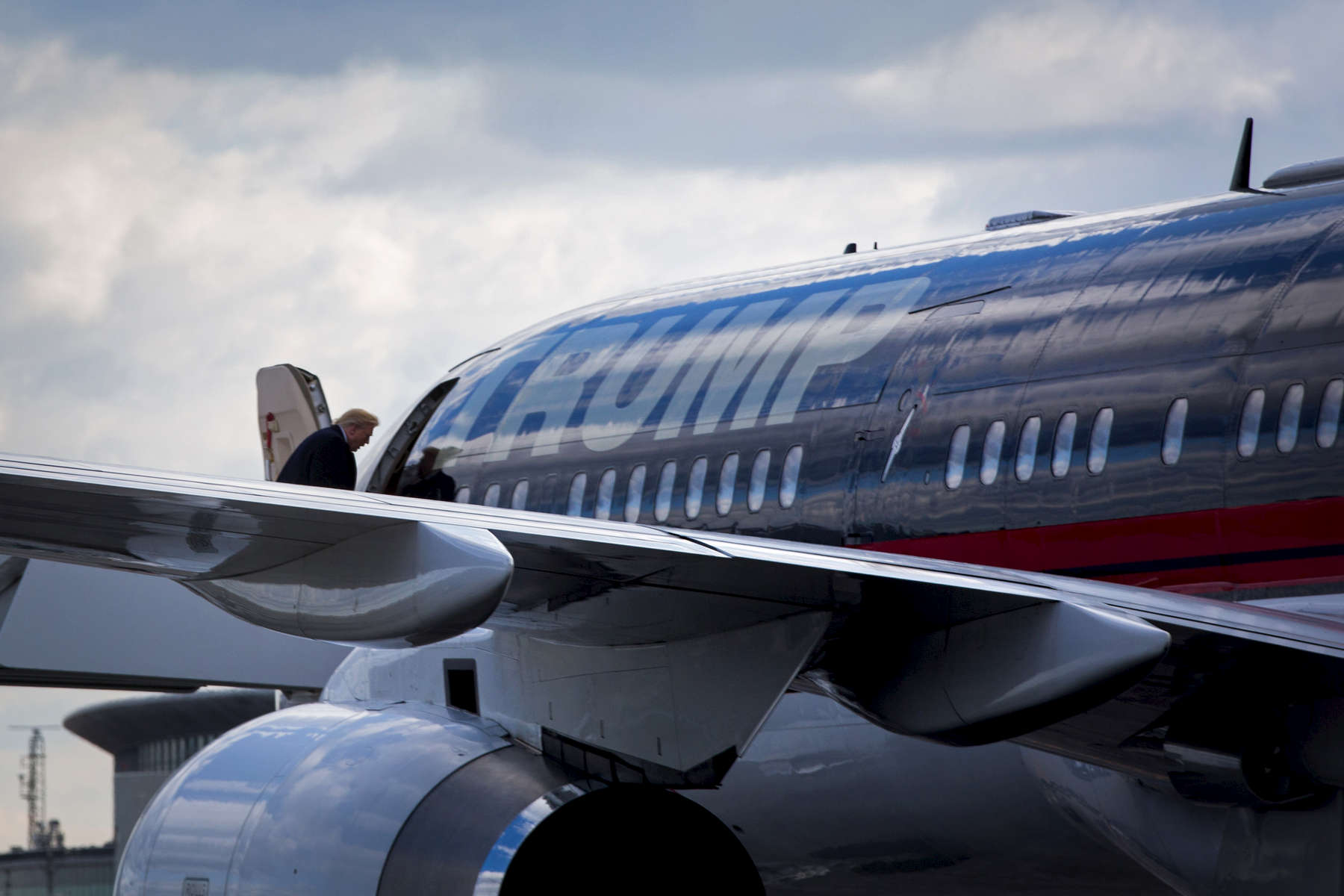 President-elect Donald Trump boards his private plane at LaGuardia Airport on Friday, Dec. 9, 2016, in New York. Trump is scheduled for rallies in Baton Rouge, La. and Grand Rapids, Mich. (AP Photo/Kevin Hagen)