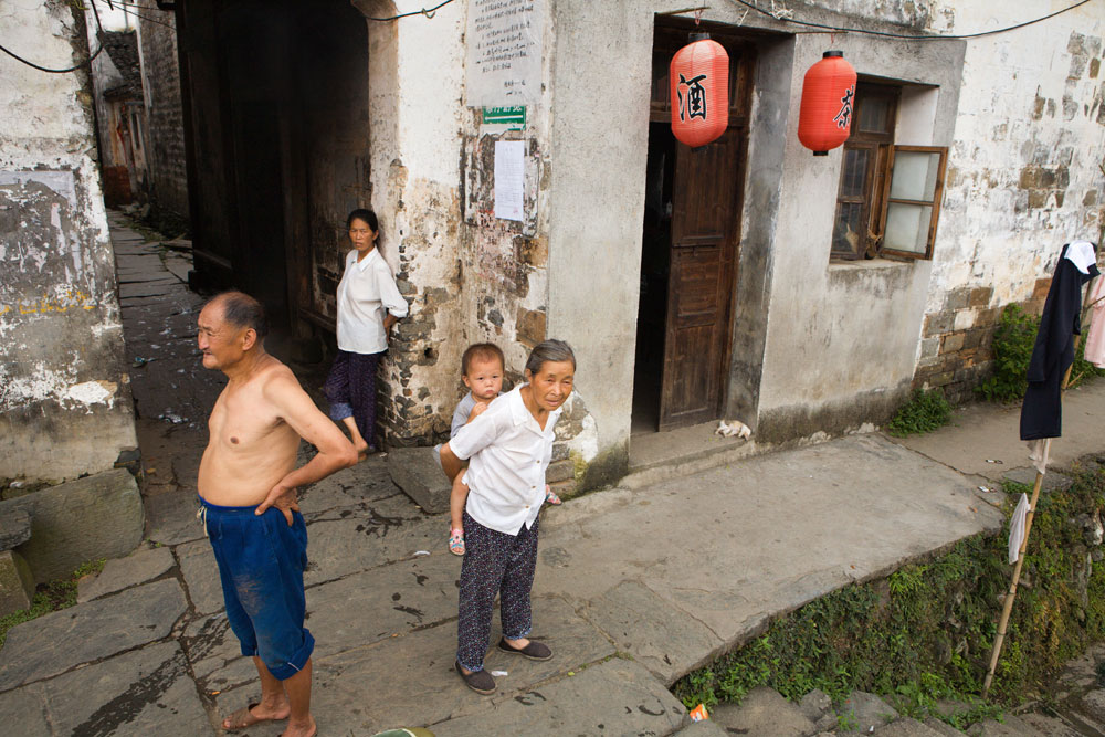 A family stands in the center of Likeng in Jiangxi Province, China. Richard U. Light Foundation.