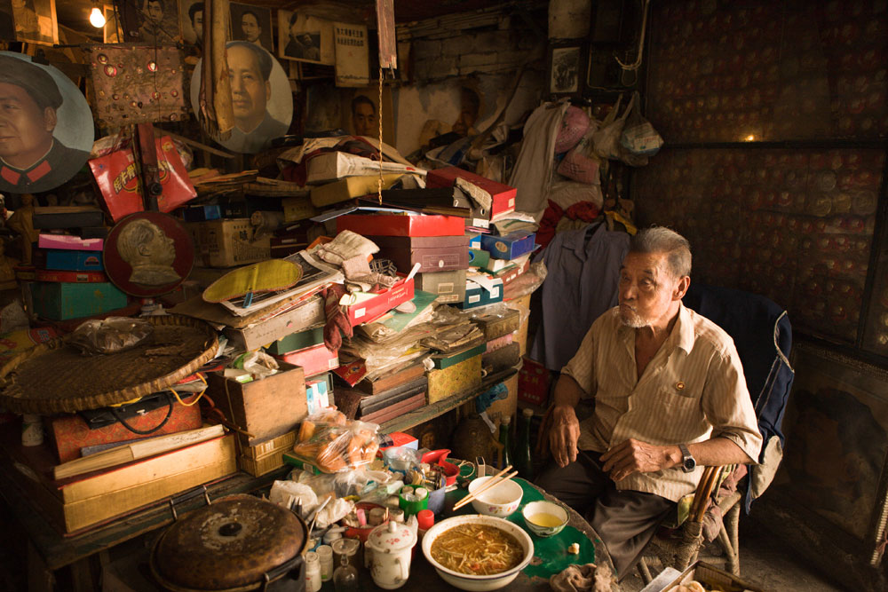 Wang Anting, 75, sits in his museum (also his house) in a Chengdu sidestreet, stuffed to the rafters with Mao memorabilia. Richard U. Light Foundation.