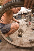 A man works on repairing his bicycle tire in Pingyao, China.Richard U. Light Foundation.