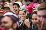 Graduating Seniors wearing colorful hats, laugh during a speech at Class Day, the day before commencement at Yale University.