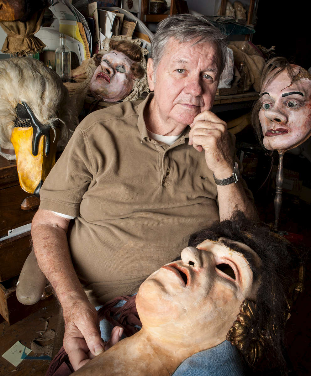 Mask maker, Hunter Spence with some of his creations in his classroom at Yale University. Yale Alumni Magazine.
