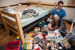 A Senior at Yale University sorts through his belongings in his dorm room at Davenport College. Yale Alumni Magazine