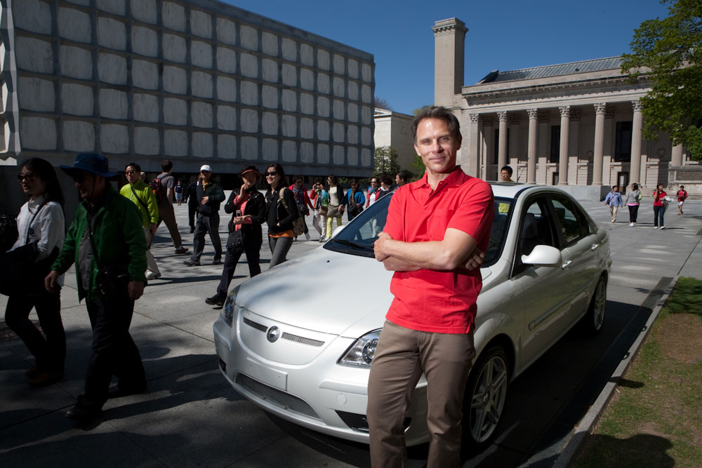 Yale University Alumni, Kevin Czinger, CEO of Coda Automotive,  with the Coda electric car on Beinecke Plaza at Yale University. Yale Alumni Magazine.