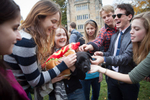 Students pet a dog in a hot dog costume as part of an event held on Cross Campus to help relieve students' stress. Yale Alumni Magazine