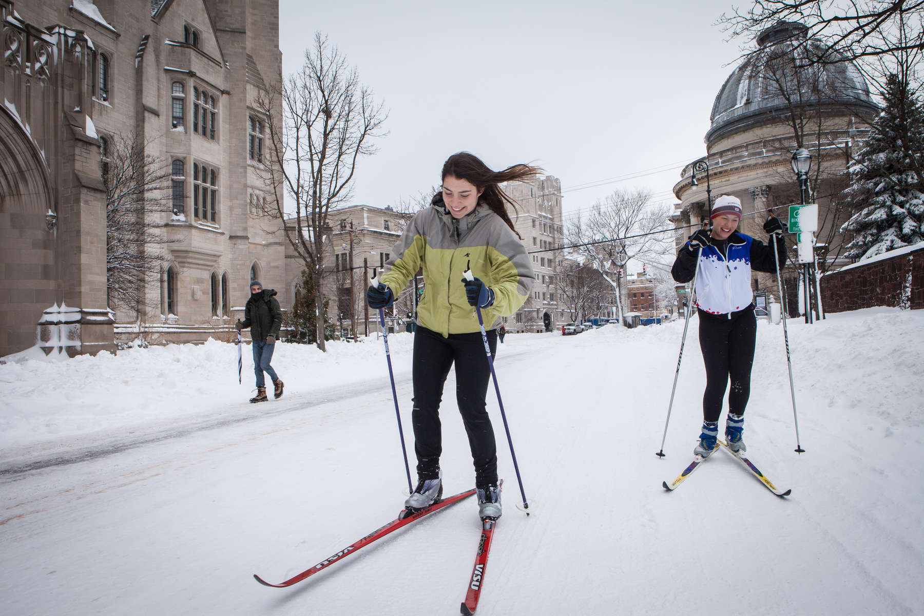 Two undergraduate students and members of the Yale University cross country ski team, take advantage of a snow day and ski on the quiet streets. Yale Alumni Magazine
