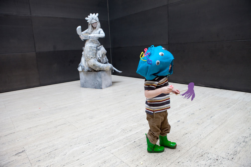 A young boy dressed as a sea monster visits the lobby of the Yale Center for British Art during a family event,