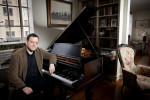 Composer of the music for the Tony Award-nominated Broadway musical TRIUMPH OF LOVE, Jeffrey Stock sits at a piano in a Manhattan apartment. Yale Alumni Magazine.
