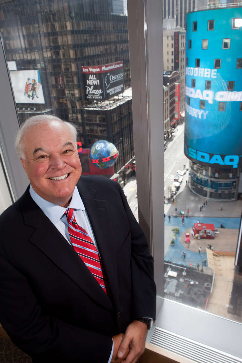 Jack Dunn of FTI consulting stands in the Manhattan office overlooking Times Square. Consulting Magazine.