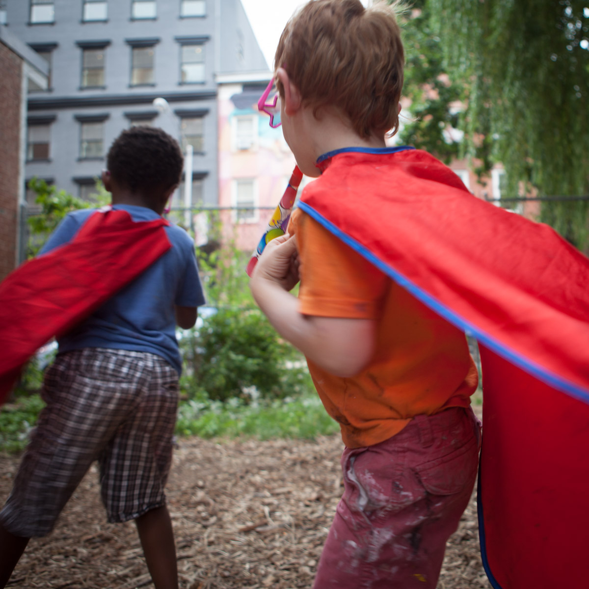 Children dressed in capes run around at a birthday party at el Jardin del Paraiso in the East Village.