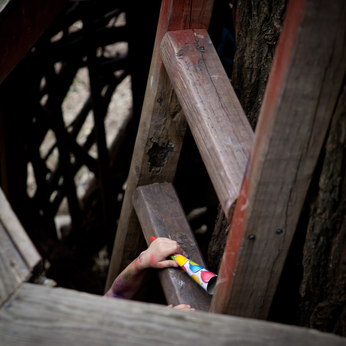 A child climbs the ladder of the treehouse while attending a birthday party at el Jardin del Paraiso in the East Village.