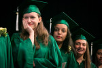 A student at The Mandell School in Manhattan, collects herself during a graduation speech.